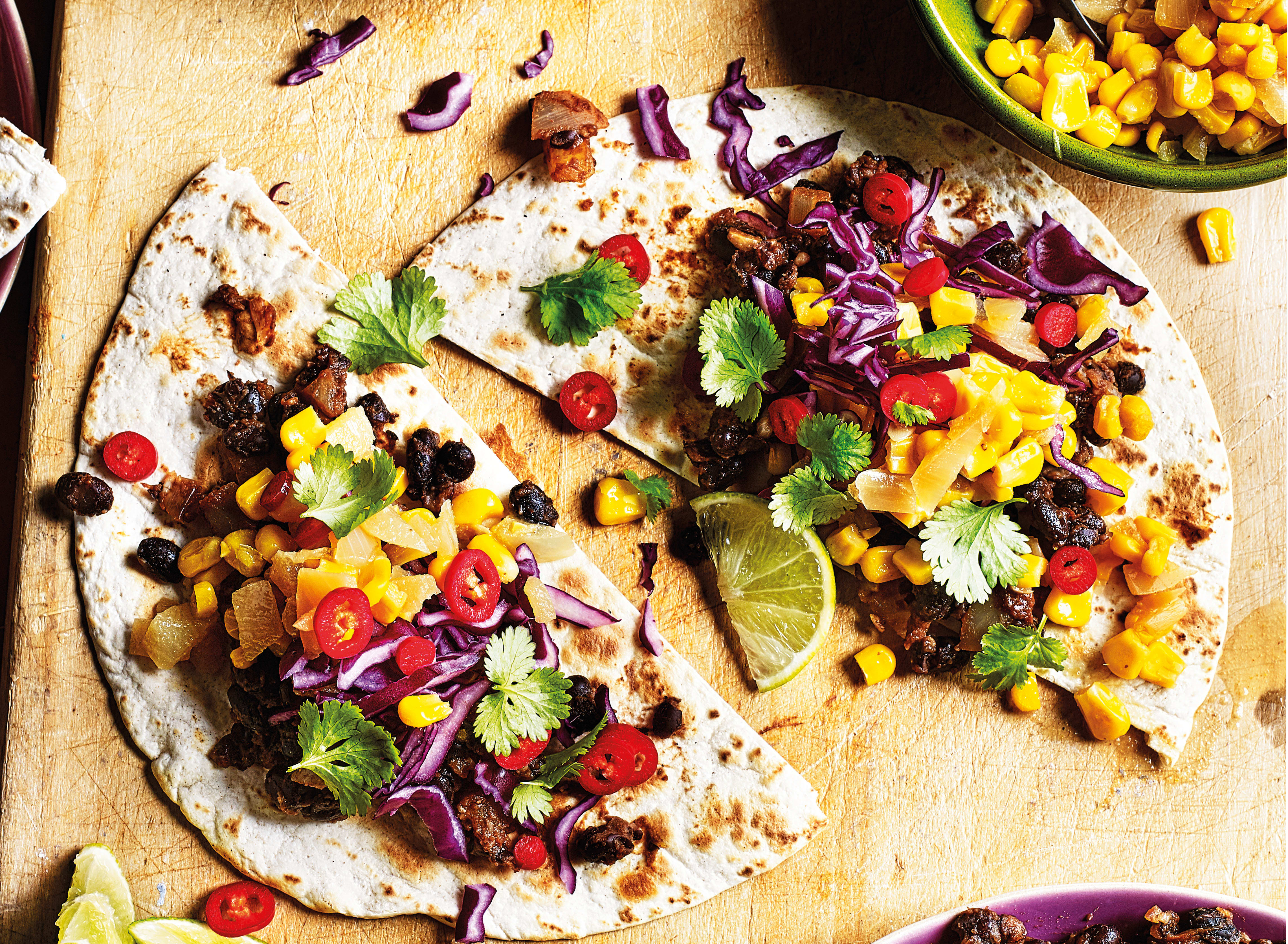 Photo of Chipotle & lime black bean tacos with sweetcorn relish by WW