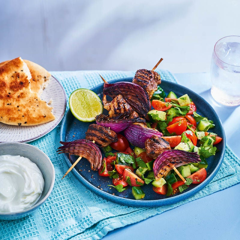 Photo of Spiced lamb kebabs with tomato & cucumber salad by WW