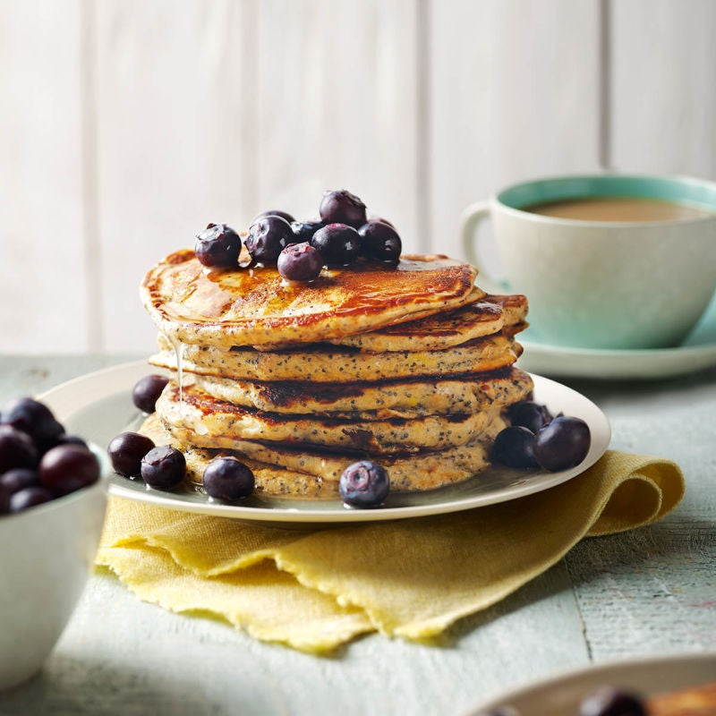 Photo of Poppy seed pancakes with lemon syrup & blueberries by WW