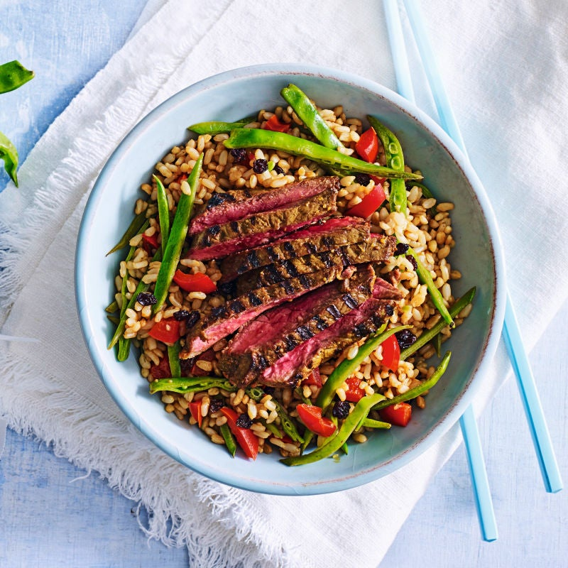 Photo of Turmeric, ginger & honey beef with warm brown rice salad by WW