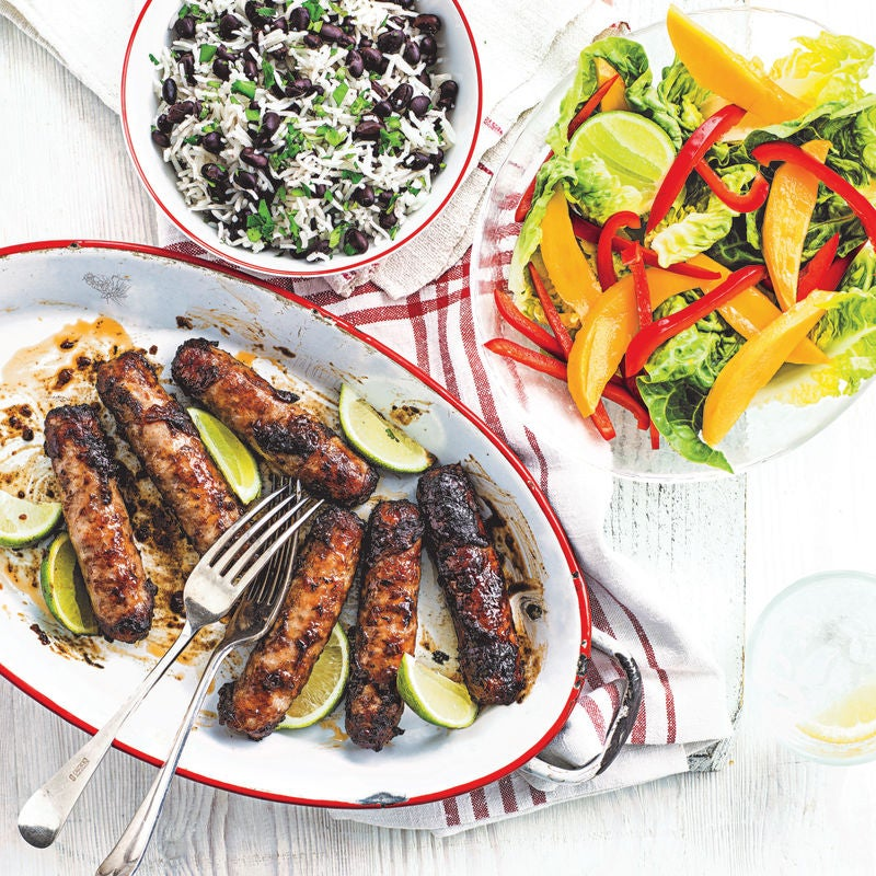 Photo of Jerk sausages with mango salad & rice by WW